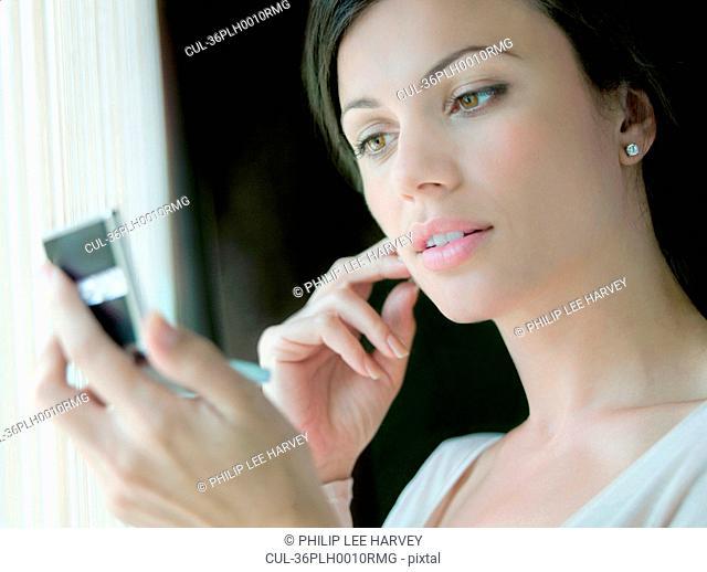 Woman admiring herself in mirror
