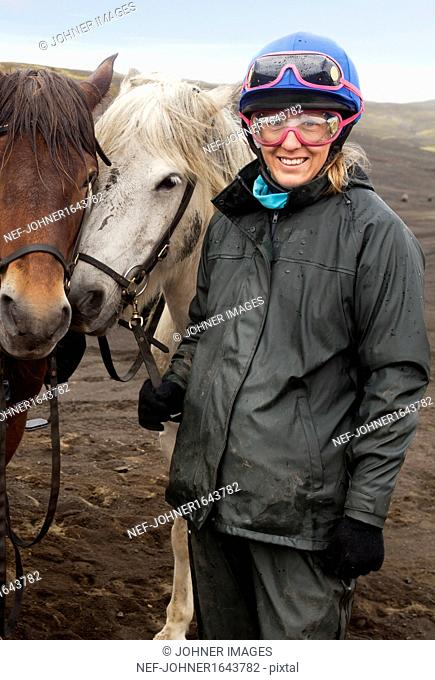 Portrait of woman with Icelandic horses