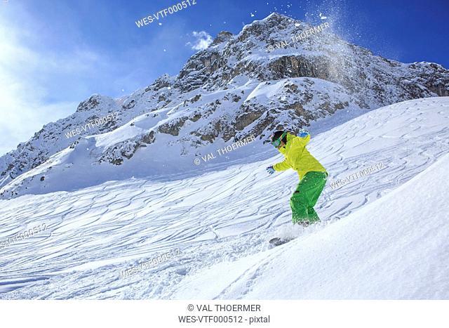 A snowboarder, snowboarding in Alps in Lech, Austria