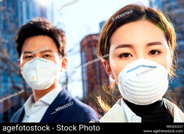 Wearing a mask of young business people