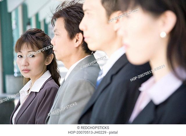 Portrait of a businesswoman with her three colleagues beside her