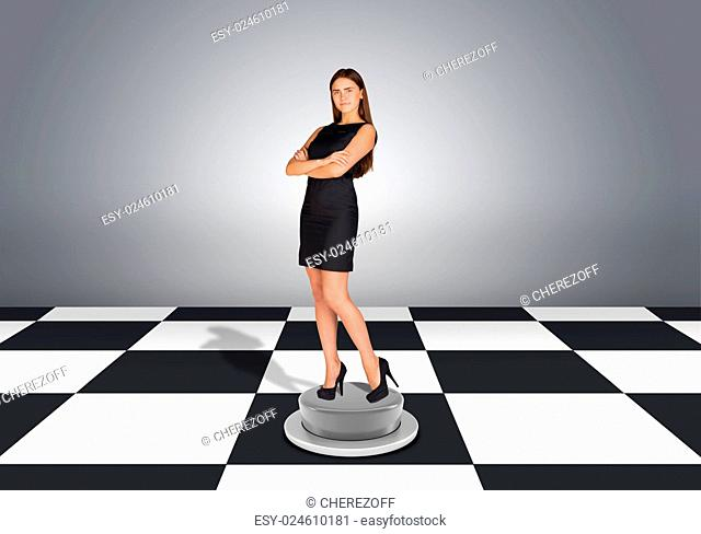 Beautiful businesswoman standing with crossed arms. Floor with checkerboard texture and gray wall