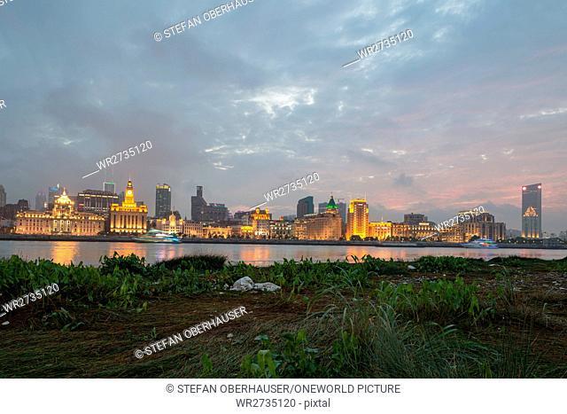 China, Shanghai, The Bund skyline at sunset