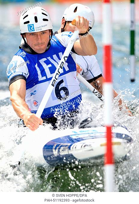 David Florence and Richard Hounslow of Great Britain paddle down the ice canal during the canoe double (C2) at the men's Canoe slalom World Cup final in...