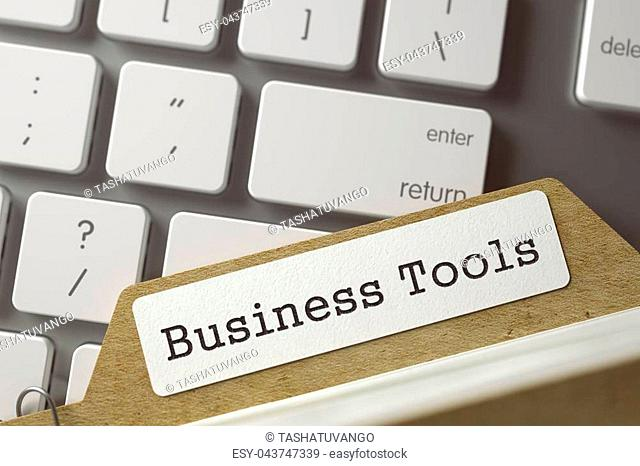 Business Tools written on Folder Index Concept on Background of White Modern Computer Keypad. Business Concept. Closeup View. Selective Focus