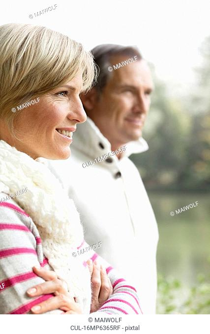 Portrait of middle aged couple outdoors