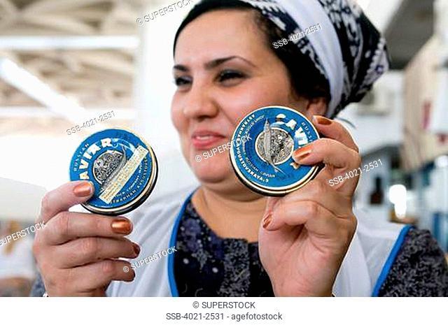 Turkmenistan, Ashgabad, Saleswoman offers caviar