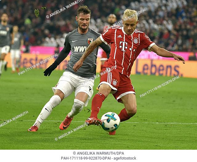 Munich's Rafinha (R) and Augsburg's Marcel Heller vie for the ball during the Bundesliga soccer match between Bayern Munich and FC Augsburg at the Allianz Arena...