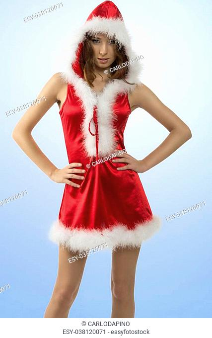 4a0b191856 portrait of attractive young girl wearing sexy red christmas dress and fur  hood in sexy pose