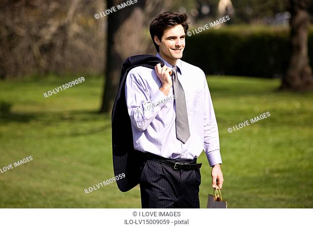 A businessman walking in a park