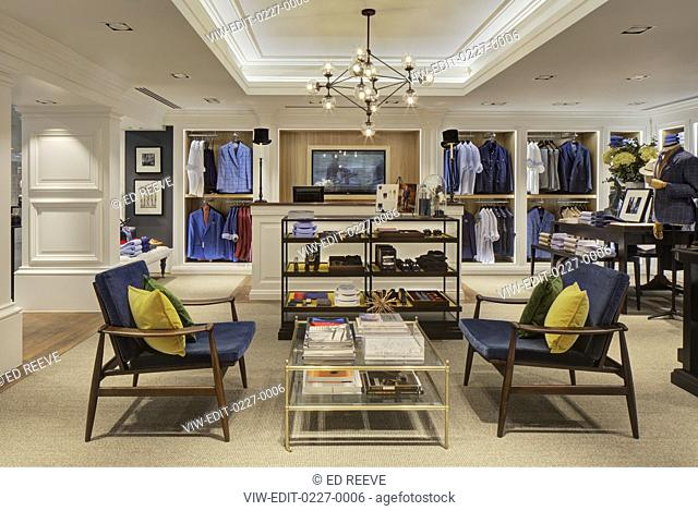 Interior with clothing display and cash desk. Hackett - Canary Wharf, London, United Kingdom. Architect: N/A, 2018