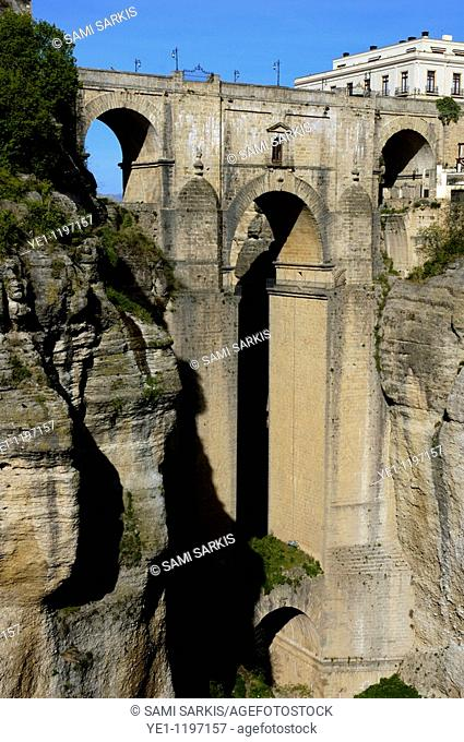 Completed in 1793, Puente Nuevo ('New Bridge') spans the deep chasm that carries the Guadalevin River through Ronda, Andalusia, Spain