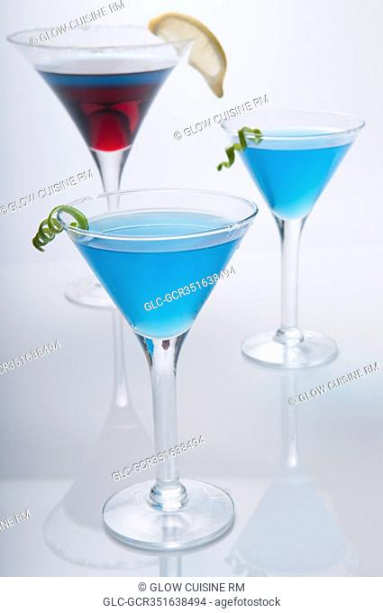 Close-up of three glasses of cocktail