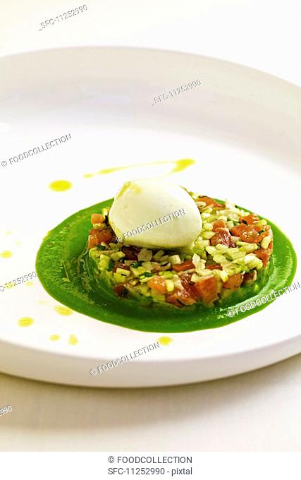 Salmon trout tartar with fennel and cucumber served on a bed of young peas with lemon balm ice cream