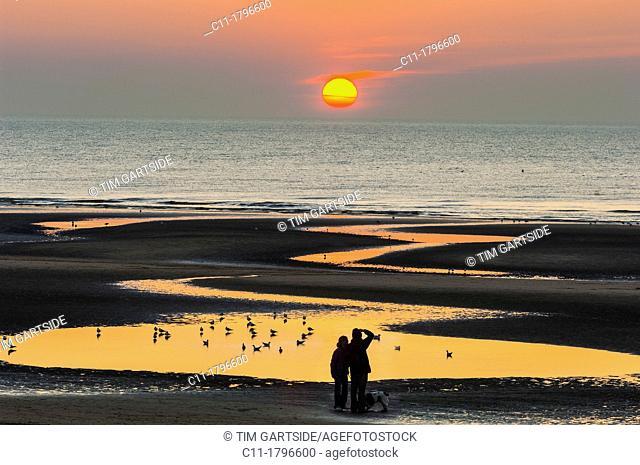 couple watching sunset, blackpool, lancashire,england,uk,europe