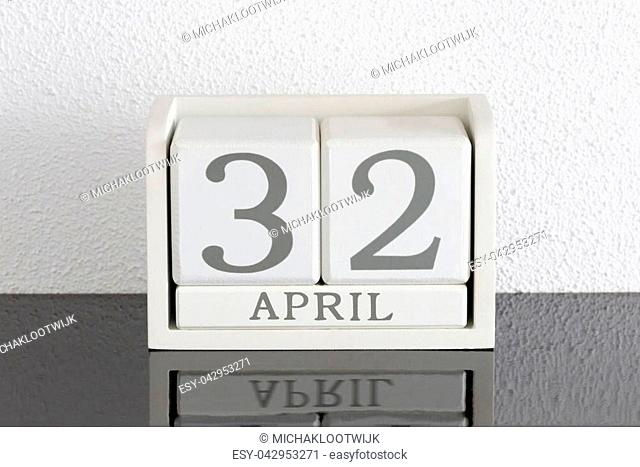White block calendar present date 32 and month April on white wall background - Extra day