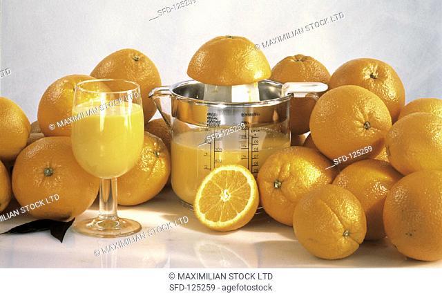 Fresh Oranges and Glass of Orange Juice