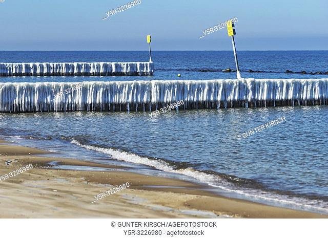 Ice covered Groynes at the beach of the Baltic Sea near Kolobrzeg. Groynes are intended to break the shaft and to prevent the erosion of the coast