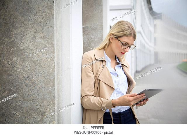 Young businesswoman looking at tablet