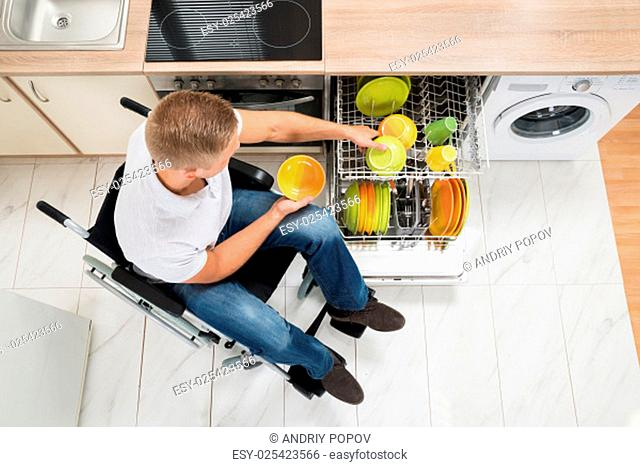 High Angle View Of Young Disabled Man In Kitchen