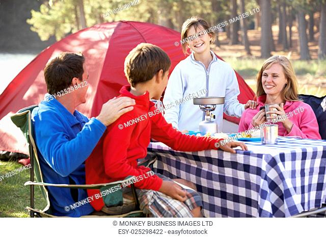 Family Enjoying Meal On Camping Holiday