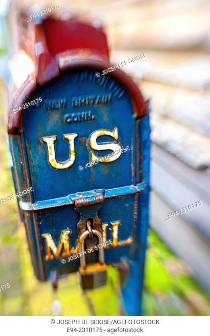 A close up of an old United States mail deposit box on a wooden wall, Alabama