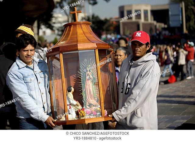 Pilgrims carry an image of the Our Lady of Guadalupe in Mexico City, December 6, 2008  Hundreds of thousands of Mexican pilgrims converged on the Our Lady of...