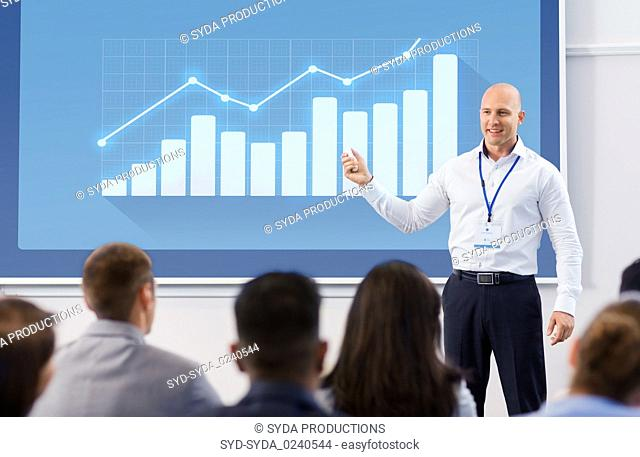 group of people at business conference or lecture