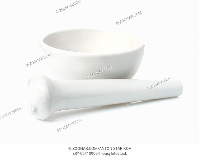 Vintage porcelain mortar and pestle isolated on white