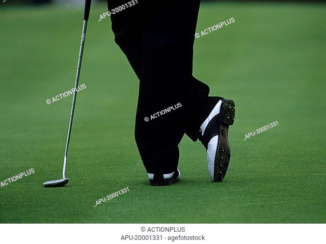 Golfer leaning on his golf club