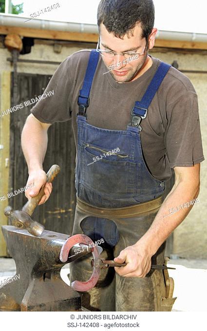 blacksmith forging a hoof