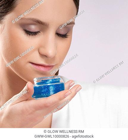 Woman smelling aroma gel