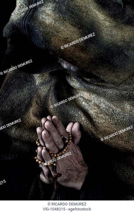 AUSTRIA , VIENNA , 02.11.2007, Hooded monk wearing cloak; praying - VIENNA, AUSTRIA, 02/11/2007
