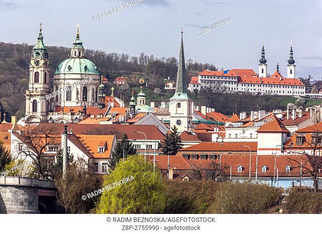 Czech Republic, Prague, St. Nicholas Church, Mala Strana, in the background Strahov Monastery, Petrin hill