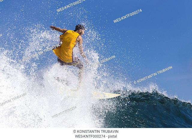 Indonesia, Bali, surfing man