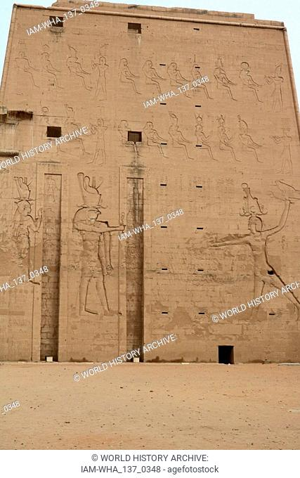 Temple of Edfu located on the west bank of the Nile River between Esna and Aswan, with a population of approximately sixty thousand people