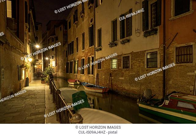Boats on canal at night, Venice, Veneto, Italy