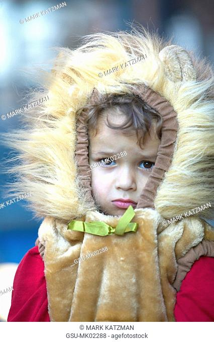 little girl in lion costume with serious expression