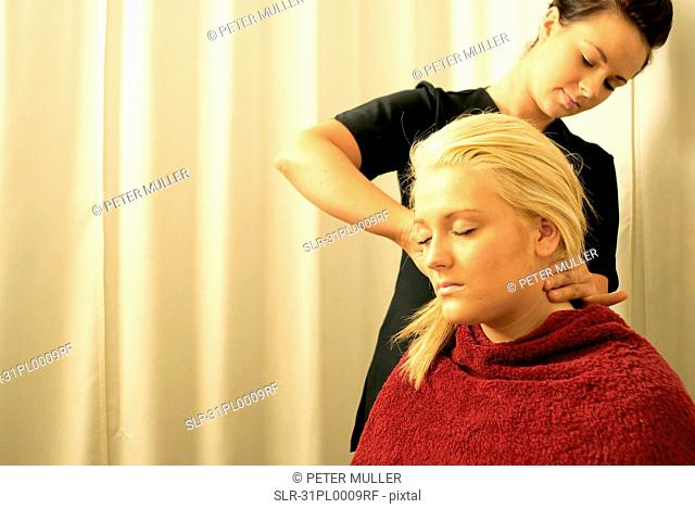 Lady having neck massage