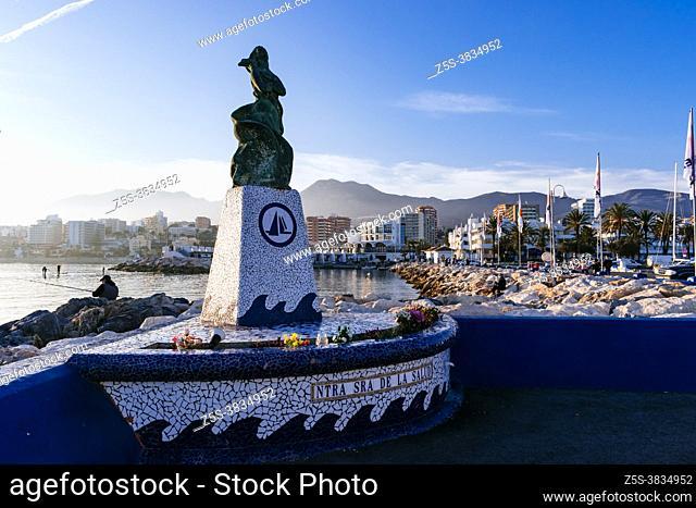 Monument to the Virgin. Our Lady of Health - Nuestra señora de la Salud. Puerto Marina in the tourist seaside town of Benalmádena, Málaga, Costa del Sol