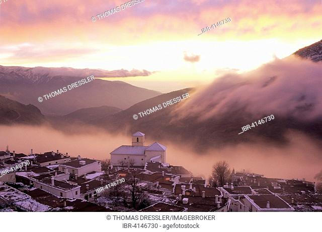 Bubion, above Poqueira Gorge, typical Alpujarran architecture, flat launa roofs, winter evening, Granada province, Andalusia, Spain