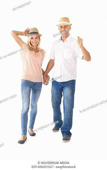 Happy couple walking holding hands