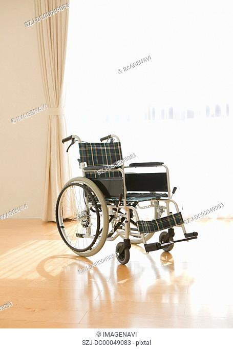 Wheelchair by a window