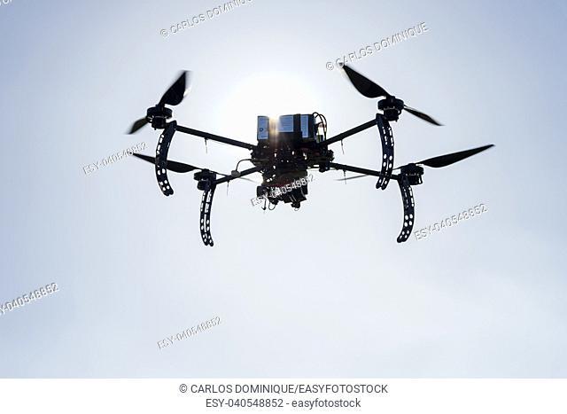 Long endurance professional drone prototype Flying at dusk