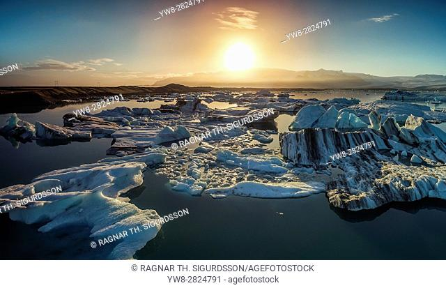 Sunset over the icebergs in the Jokulsarlon Glacial Lagoon, Iceland