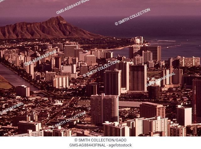 Aerial view of Honolulu looking east toward Diamondhead, the extinct volcano, Honolulu, Hawaii, October, 1973