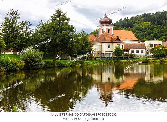 Nedvedice church reflected on a pond. Moravia, Czech Republic
