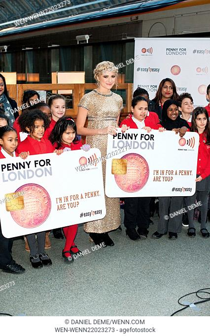 Pixie Lott sings Christmas carols with local primary school children at St Pancras International station in support of Penny for London charitable revolution