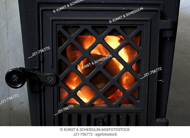 Fire burning in an iron fire-place