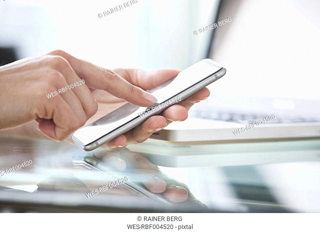Close-up of woman's hands using smartphone